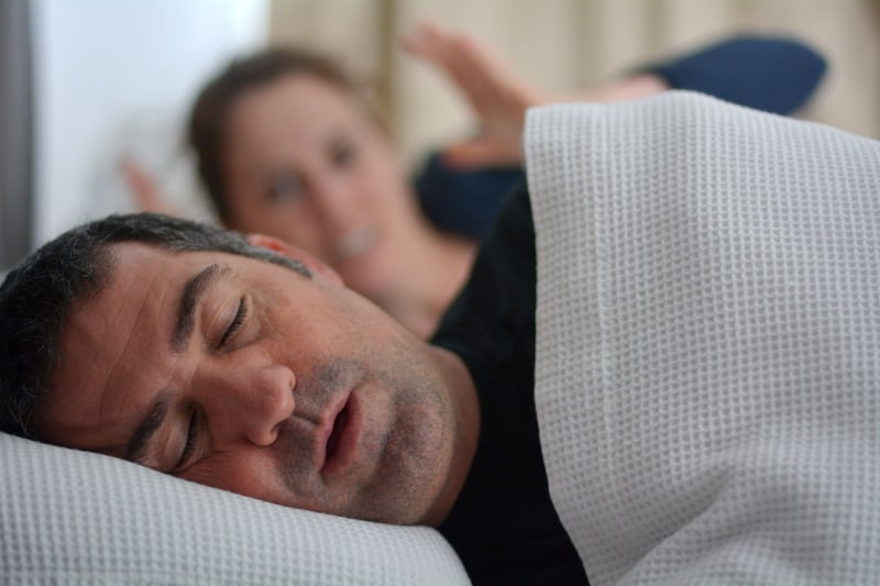 man snoring with potentially untreated sleep apnea